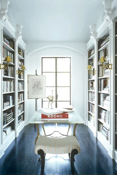 25 Stylish Built-In Bookshelves - Floor-to-Ceiling Shelving Ideas thin bookshelf through the door